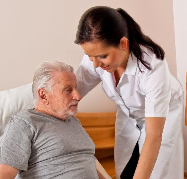 Caregiver assiting an old man