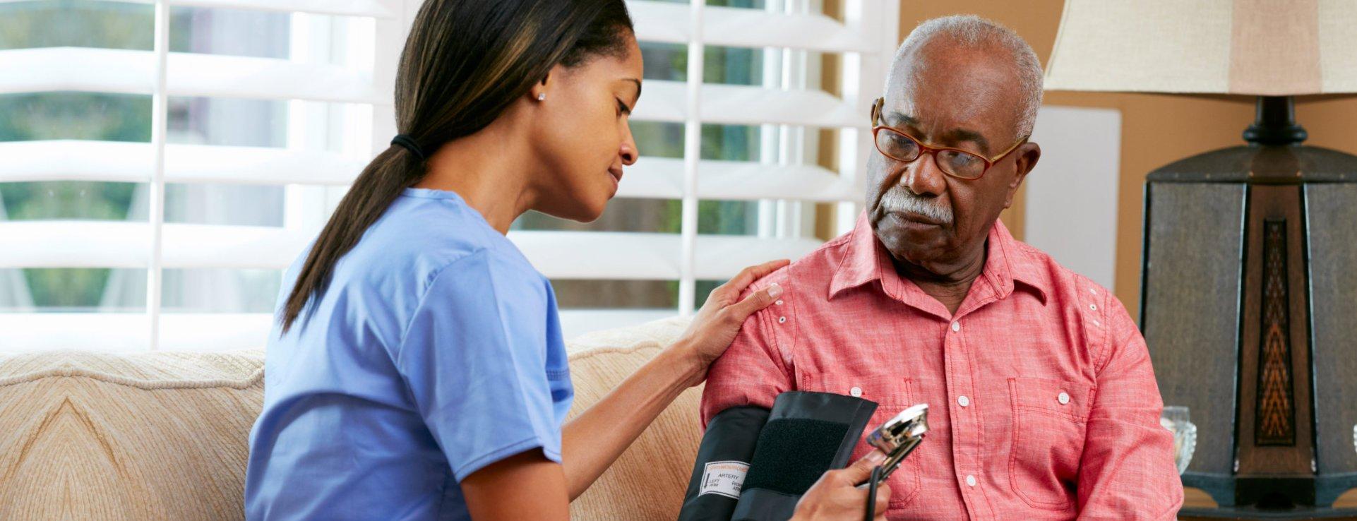 Nurse checking the blood presure of an elderly man