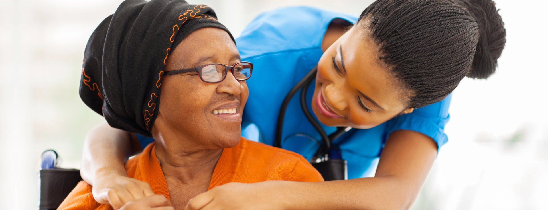 An elderly woman and caregiver